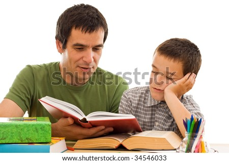 Schoolboy asleep while his father reading from a red color book - isolated
