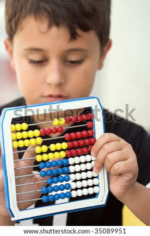 Schoolboy calculate with abacus ,shallow dof