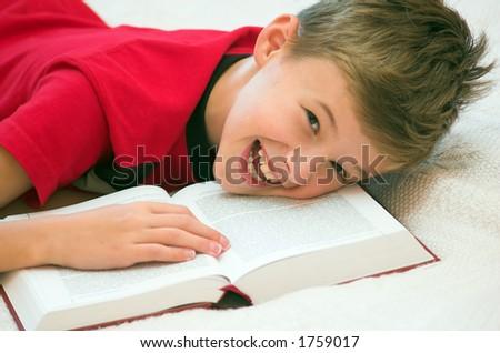 Schoolboy having fun during studying