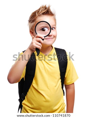 Schoolboy holding the magnifying glass isolated on white