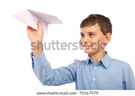 Schoolboy throwing a paper plane, isolated on white background