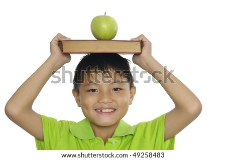 schoolboy with book and apple - stock photo