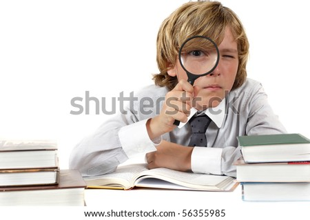 Schoolboy with books and magnifying glass isolated on white