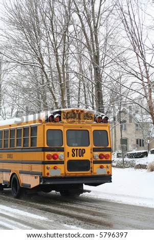 Schoolbus on the snowy road