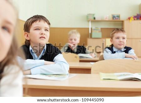 Schoolchild behind desks at school