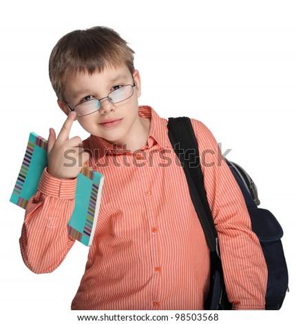 Schoolchild in glasses against white blackboard