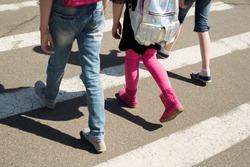 Schoolchildren crossing the road on their way to school