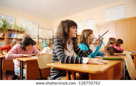 Schoolchildren during lesson in classroom.