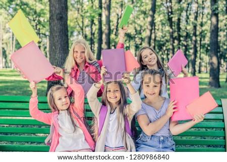 Schoolfriends with Schoolstuffs in the park #1280986840