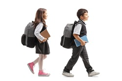 Schoolgirl and schoolboy with backpacks walking  isolated on white background