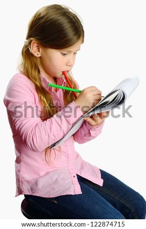 schoolgirl drawing with color pencils