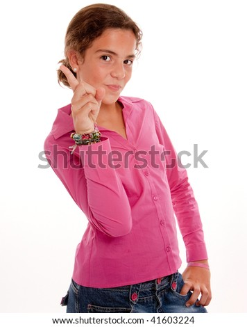 Schoolgirl in pink raising her finger volunteering