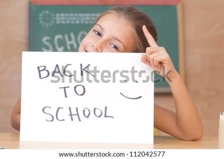 Schoolgirl in the classroom - back to school