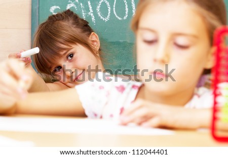 Schoolgirl in the classroom - back to school