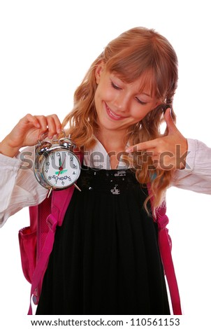 schoolgirl pointing on retro alarm clock holding in hand