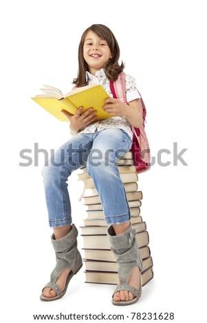 Schoolgirl sitting on the books