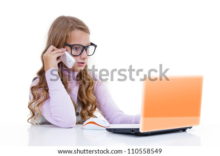 Schoolgirl with her white netbook and mobile phone