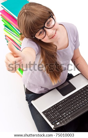 schoolgirl with laptop and school, showing OK sign ,  isolated on white