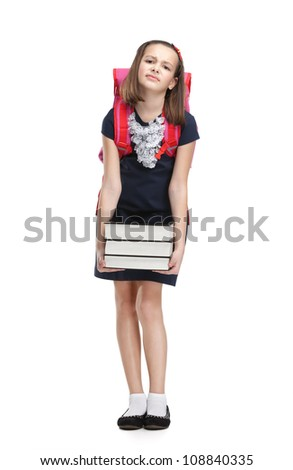 Schoolgirl with the briefcase and the pile of heavy books, isolated, white background