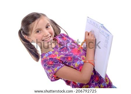 Schoolgirl writing on agenda on the white background
