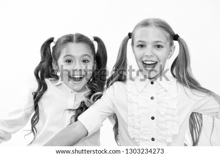 Schoolgirls with cute ponytails hairstyle and brilliant smiles. Best friends excellent pupils. Perfect schoolgirls tidy appearance glad to meet you. Meet new friends in school. Let us get acquainted.