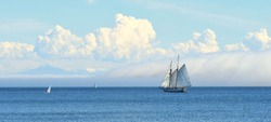 Schooner, Fog, and Puffy Clouds