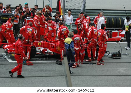 Schumacher On Grid with Pit Crew