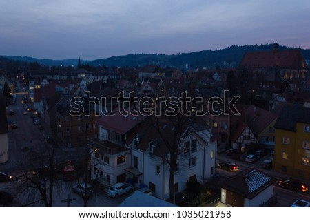 schwaebisch gmuend citylights at blue hour with deepblue sky in the late evening in south germany historical city of schwaebisch gmuend #1035021958