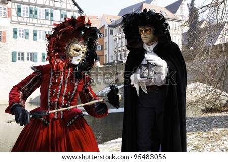 SCHWAEBISCH HALL, GERMANY - FEBRUARY 12: An unidentified couple in costume attend the HALLia VENEZIA event in the old town Schwaebisch Hall, Germany on Feb. 12, 2012. HALLia VENEZIA  was founded in 1998 and was inspired by the Venetian Carnival.