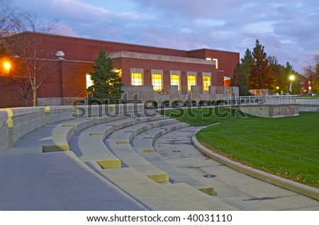 Schwitzer Student Center and part of an amphitheater on the campus of the University of Indianapolis in Indiana with lights and clouds at night