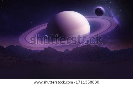 Sci-fi wallpaper of Saturn planet and mountains in the Earth. Night landscape. Elements of this image furnished by NASA Foto d'archivio ©