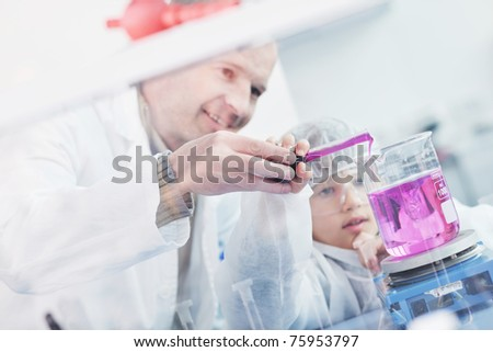 science and chemistry classes with teacher and young school boy at bright lab