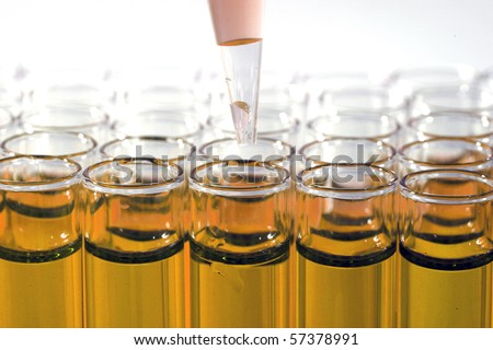 Science and Medical Research Test Tubes, being filled with pipette's and other filling devices