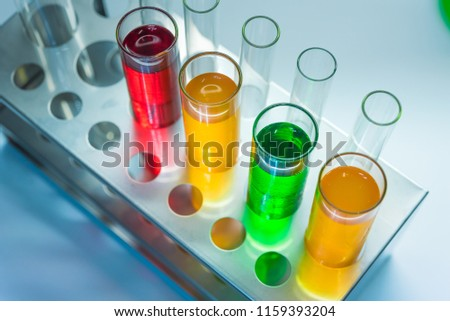 Science chemical tubes with colorful liquid. Medical laboratory research background. pharmacology and biotechnology concept. Copy space for texting.