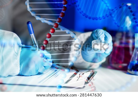 science, chemistry, medicine and people concept - close up of young scientist with chemical sample taking notes on clipboard and making test or research in laboratory over dna molecule structure