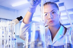 Science concept. Female scientist working in laboratory.