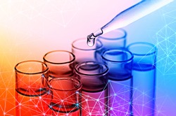 science dropper and laboratory test tubes