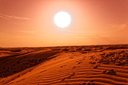 Science fiction landscape / fantasy landscape: sand dunes in front of an orange and burning sun, sand exoplanet, surreal landscape with a dominant orange, looks like Dune