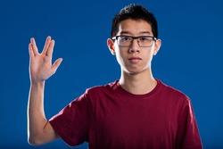 science fiction lover salutation sometimes looks like a nerd stigma, portrait of an asian descent fiction fan