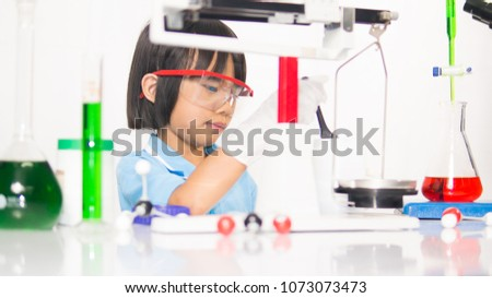 Science kids concept, kids learning science in laboratory on gray whit background. Cute child kid playing and funny in knowledge about lab experiment and instrument of science to be scientist.
