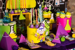 science party candy bar with pop cakes and sweets decor