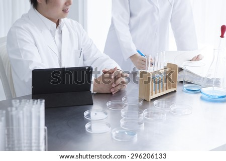 Science student looking at tablet pc in the lab at the university