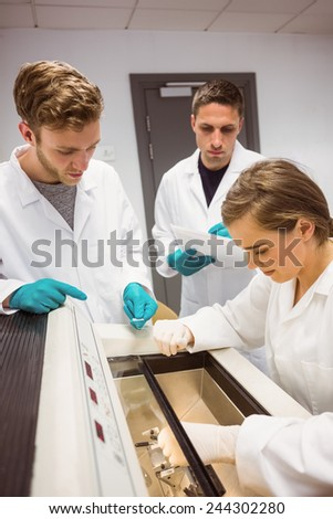 Science students using incubator in the lab at the university