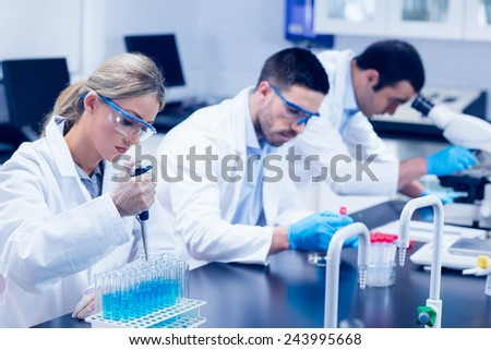 Science students working with chemicals in lab at the university