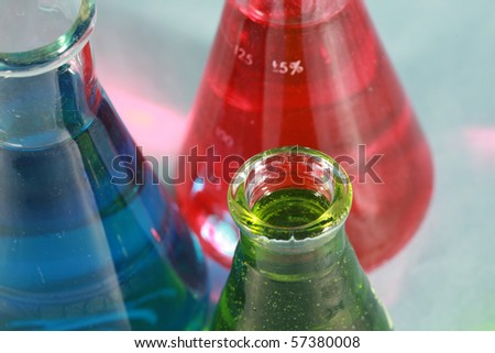 scientific and medical research beakers filled with various experiments with various colors and textures