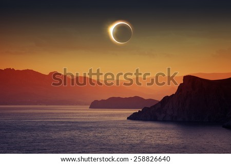 Scientific background, astronomical phenomenon - full total solar eclipse, mountains and sea