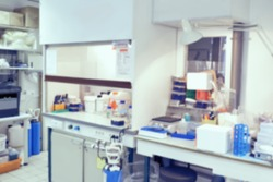 Scientific background: blurred interior of modern cell culture room in modern laboratory. This is defocused background image, no focus point here. Ideal as a presentation background.