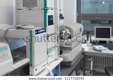 Scientific background out of focus. Modern laboratory interior out of focus, including equipment
