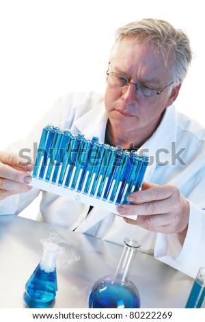 Scientific concept--Scientist holding test tubes with liquid over a white background with room for your text.