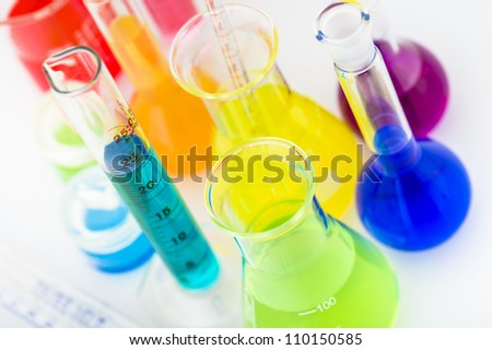 Scientific laboratory glassware filled with color liquid ready for chemical experiment in a science research lab